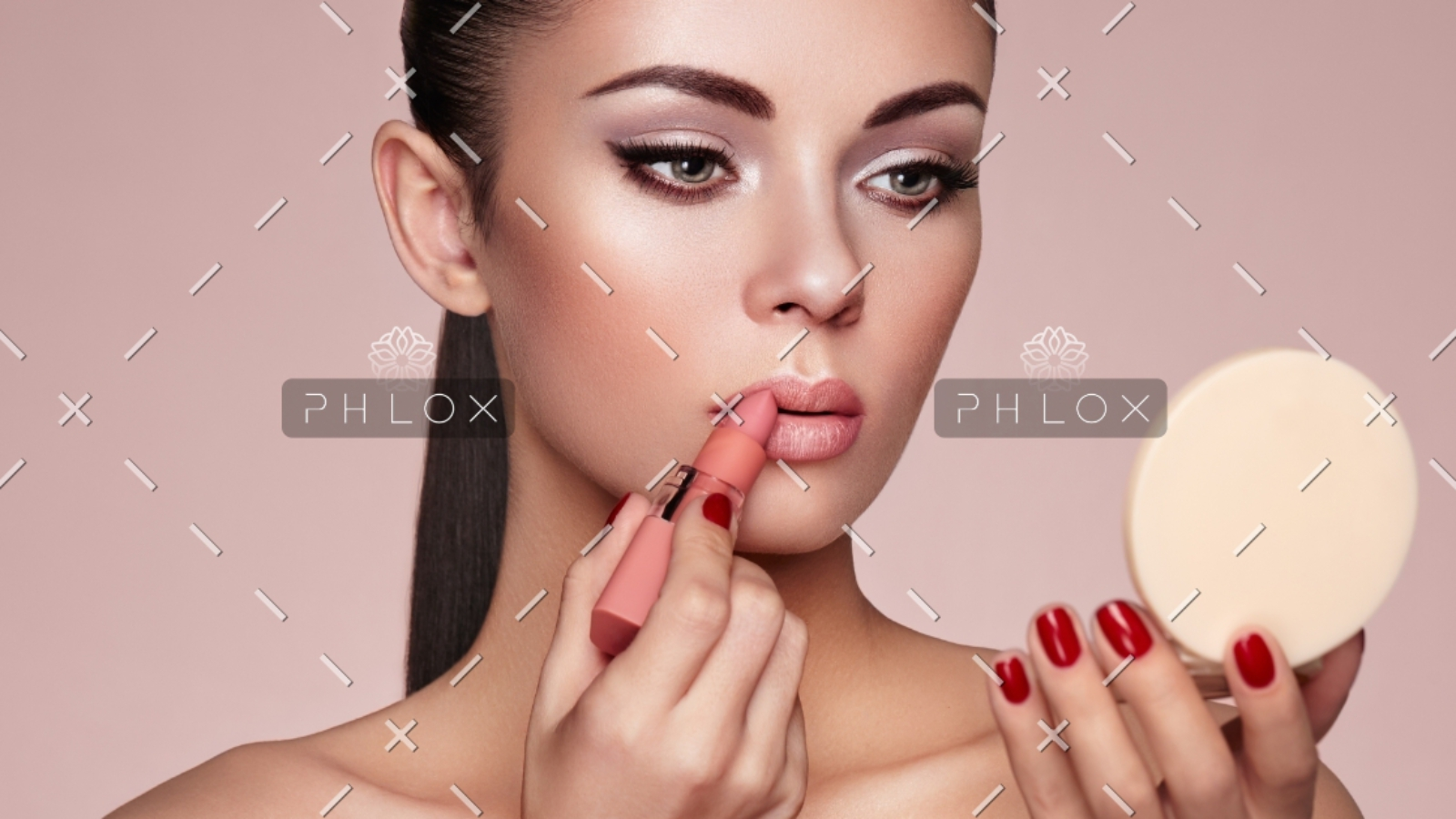 demo-attachment-551-beautiful-woman-paints-lips-with-lipstick-PMB6YWP-1